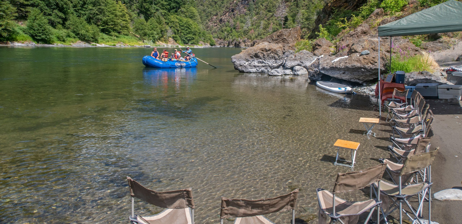 Floating into riverside camp - Luxury camping (glamping) rafting trips